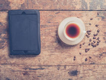 Tablet coffee and beans on table Stock Images