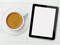 Tablet and coffee cup Stock Images