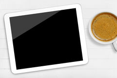 Tablet and coffee cup Royalty Free Stock Images