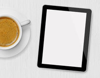 Tablet and coffee cup. On wood with blank screen Stock Image