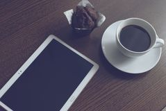 Tablet coffee and muffin stock images
