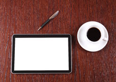 Tablet, coffee and pen Royalty Free Stock Image
