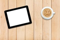 Tablet and coffee with smile sign Stock Photos