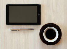 Tablet with coffee on table Stock Images