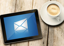 Tablet with coffee on table. Show morning Royalty Free Stock Photography