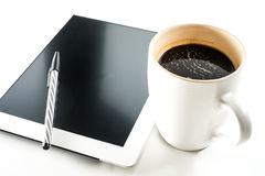 Tablet and coffee. In white Stock Images