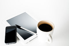 Tablet and coffee. In white Royalty Free Stock Photo