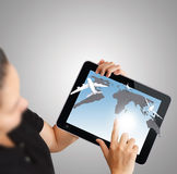 Tablet computer with aircraft as concept. Businesswoman shows tablet computer with aircraft as concept Royalty Free Stock Images