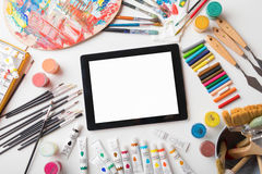 Tablet computer on artists table Royalty Free Stock Image