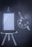 Tablet computer as easel for painting Royalty Free Stock Photos
