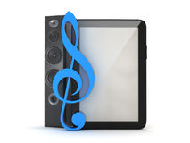 Tablet computer, audio speaker and blue clef Royalty Free Stock Photo