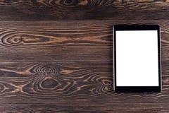 Tablet-Computer auf den alten hölzernen Brettern Weißer Bildschirm lizenzfreie stockbilder