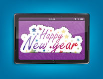 Tablet computer background. Tablet computer with the message Happy new year on a blue background Stock Photos