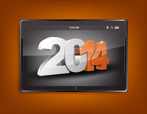 Tablet computer with a 2014 background. Tablet computer with the message 2014 on a orange background stock illustration