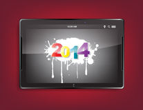 Tablet computer with a 2014 background. Tablet computer with the message 2014 on a red background stock illustration
