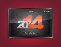 Tablet computer with a 2014 background. Tablet computer with the message 2014 on a red background Stock Photo