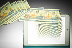 Tablet computer and banknote Stock Image