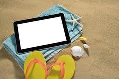 Tablet computer on the beach Stock Photos