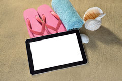 Tablet computer on the beach Stock Photo