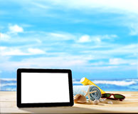 Tablet computer on the beach Royalty Free Stock Photography