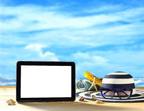 Tablet computer on the beach Royalty Free Stock Images