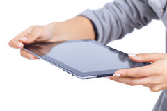 Tablet computer being hold by two hands Stock Image