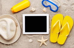 Tablet computer with blank screen on beach sand Royalty Free Stock Images