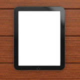 Tablet computer with blank screen on wooden background Royalty Free Stock Photo