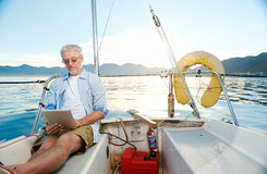 Tablet computer on boat Royalty Free Stock Photo