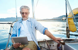 Tablet computer on boat Royalty Free Stock Images
