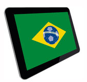 Tablet computer with Brazilian flag perspective royalty free stock image