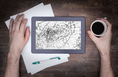 Tablet computer with broken glass. Screen destroyed royalty free stock photo