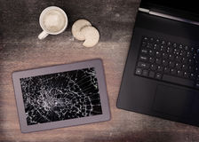 Tablet computer with broken glass Stock Photography