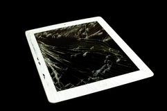 Tablet computer with broken glass screen. Isolated on black background royalty free stock photos