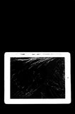 Tablet computer with broken glass screen Stock Photography