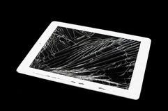Tablet computer with broken glass screen. Isolated on black background stock image