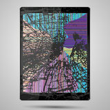 Tablet computer with broken glass screen isolated on gray background Royalty Free Stock Images
