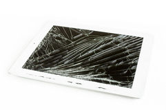 Tablet computer with broken glass screen. Isolated on white background royalty free stock images
