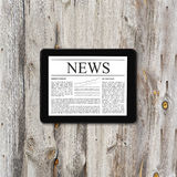 Tablet computer with business news Stock Photography