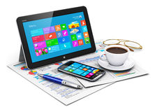 Tablet computer and business objects. Creative abstract business office work and mobile workplace corporate concept: tablet computer PC with color touchscreen Royalty Free Stock Images