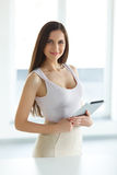 Tablet computer. Business woman with digital tablet computer royalty free stock photography
