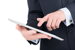 Tablet computer in a businessman hands Stock Image