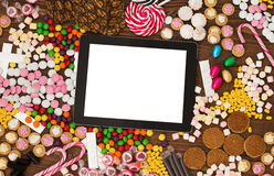 Tablet computer and candy Royalty Free Stock Photos
