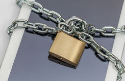Tablet computer with chain and padlock Royalty Free Stock Image