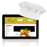 Tablet computer with chef hat and recipe website template Stock Images