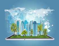 Tablet computer and city of skyscrapers Stock Image