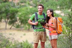 Tablet computer - couple hiking using internet app royalty free stock image