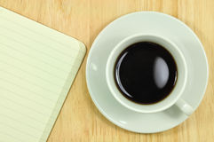 Tablet computer and a cup of coffee on the desk Royalty Free Stock Photos