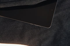 Tablet computer is on the dark bag a white background Stock Images