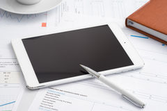 Tablet computer on desk in office Stock Photo
